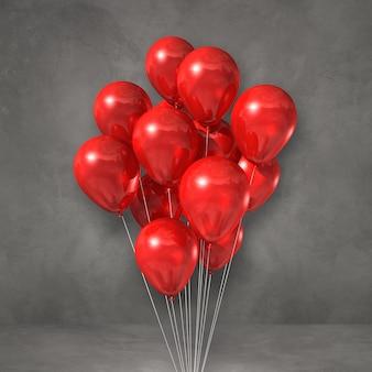 Kilka czerwonych balonów na tle szarej ściany. renderowanie ilustracji 3d