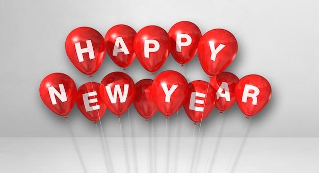 Kilka czerwonych balonów szczęśliwego nowego roku na białym tle betonu. baner poziomy. renderowanie ilustracji 3d
