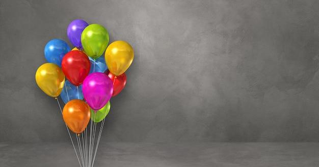 Kilka kolorowych balonów na tle szarej ściany. baner poziomy. renderowanie ilustracji 3d