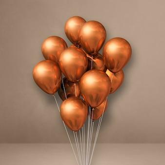 Kilka miedzianych balonów na beżowej ścianie. renderowanie ilustracji 3d