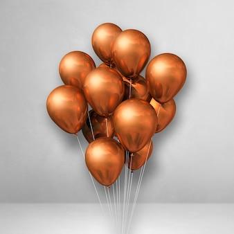 Kilka miedzianych balonów na tle białej ściany. renderowanie ilustracji 3d