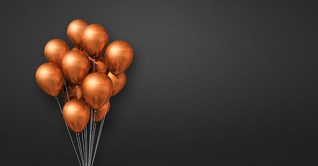 Kilka miedzianych balonów na tle czarnej ściany. baner poziomy. renderowanie ilustracji 3d