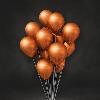 Kilka miedzianych balonów na tle czarnej ściany. renderowanie ilustracji 3d