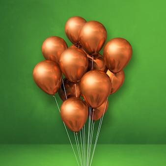 Kilka miedzianych balonów na tle zielonej ściany. renderowanie ilustracji 3d