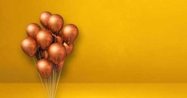 Kilka miedzianych balonów na tle żółtej ściany. baner poziomy. renderowanie ilustracji 3d