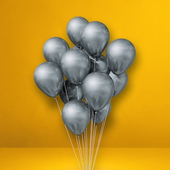 Kilka srebrnych balonów na tle żółtej ściany. renderowanie ilustracji 3d