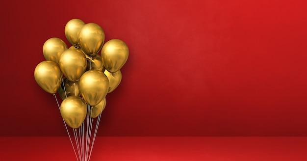 Kilka złotych balonów na czerwonej ścianie