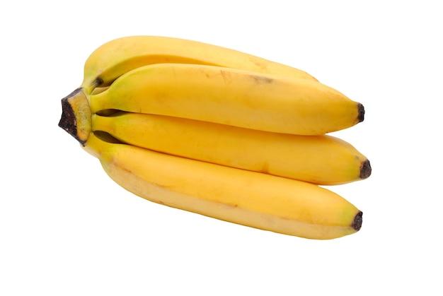 Kilka żółtych bananów na białym tle
