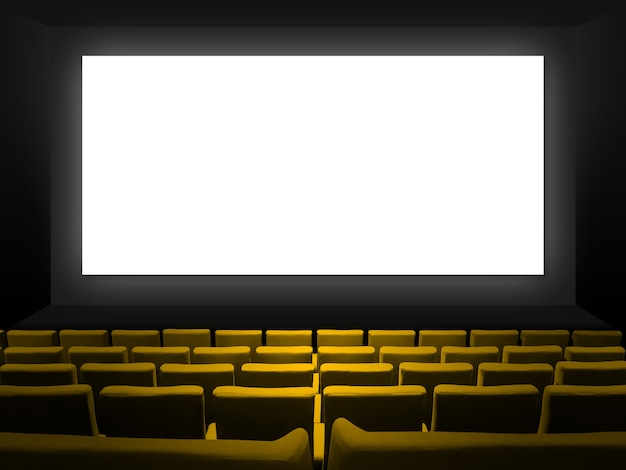 Kino z fotelami z żółtego aksamitu i pustym białym ekranem. skopiuj tło przestrzeni