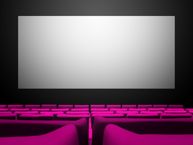 Kino z siedzeniami z różowego aksamitu i pustym białym ekranem. skopiuj tło przestrzeni