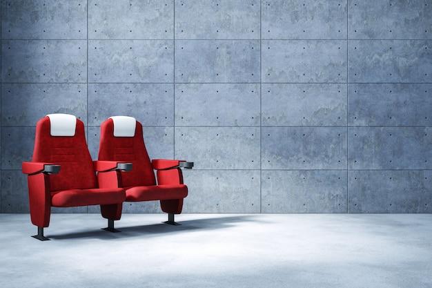 Kinowy siedzenia i kopii przestrzeń, betonowej ściany tło