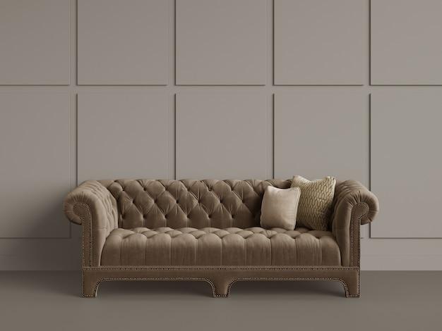 Klasyczna pikowana sofa w pustym pokoju z szarymi ścianami. minimalna koncepcja