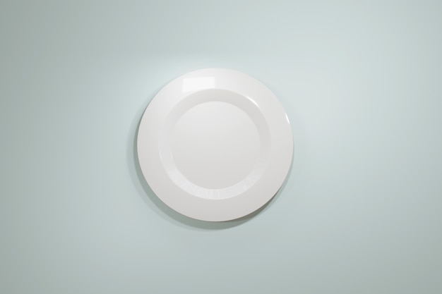 Klasyczny biały talerz ceramiczny do restauracji lub kawiarni z góry na jasnoniebieskim pastelowym tle.