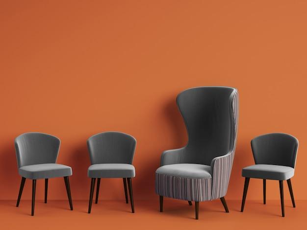 Klasyczny fotel wśród prostych krzeseł w szarym kolorze z miejscem do kopiowania