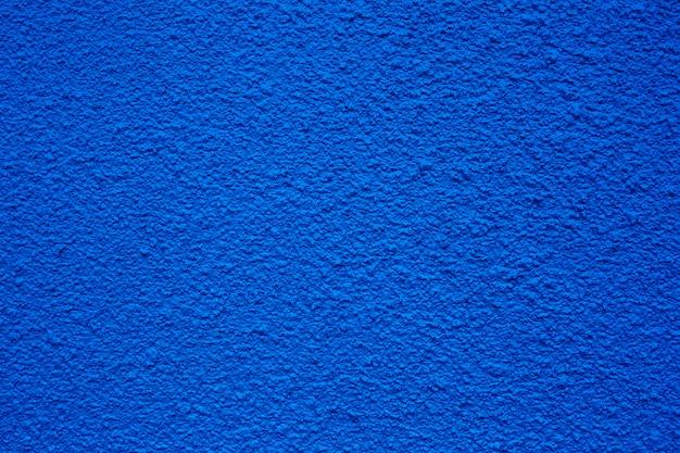 Klasyczny niebieski szorstkie tło lub tekstury