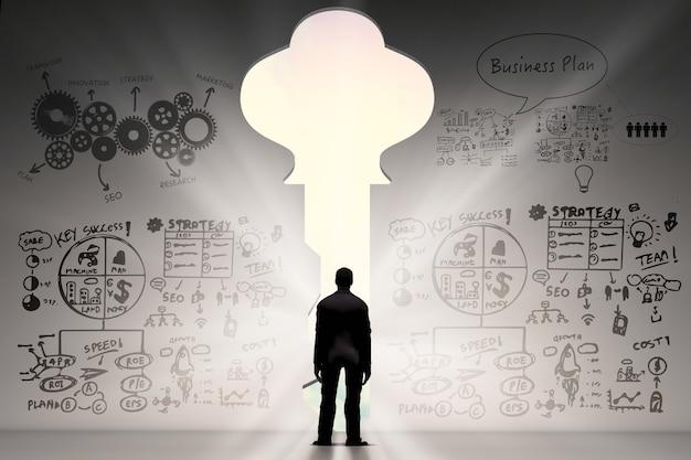 Klucz do koncepcji sukcesu z widokiem z tyłu biznesmena i tła biznesowego
