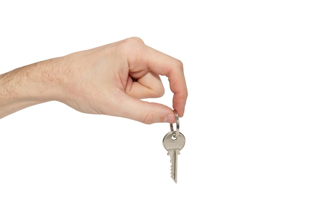 Klucz w dłoni na białym tle