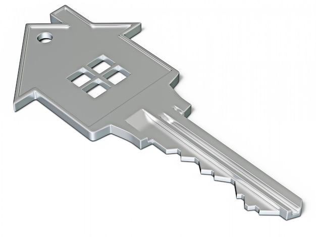 Klucz w kształcie domu na białym tle