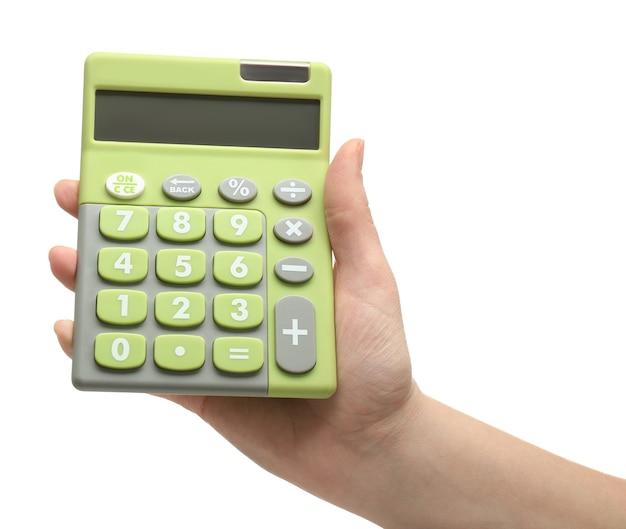 Kobieca ręka trzyma kalkulator