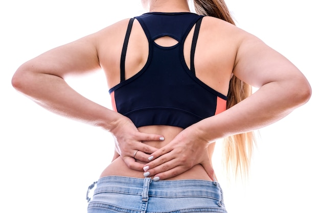 Kobiece ręce na plecach zbliżenie, koncepcja bólu
