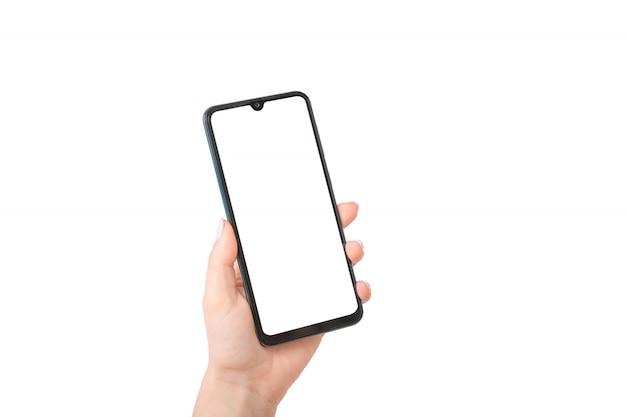 Kobiecej ręki trzymającej telefon komórkowy z pustym ekranem, makieta telefonu