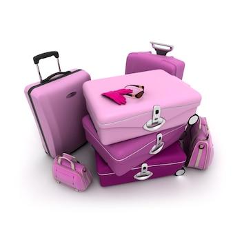 Kobiecy bagaż w różu i fiolecie z damskimi rękawiczkami i okularami przeciwsłonecznymi na górze