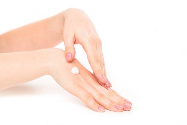 Kobiet ręki z pięknym manicure'em odizolowywającym