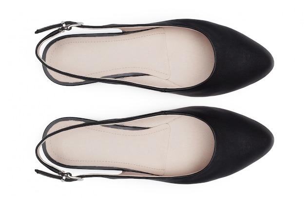 Kobieta buty na bielu. widok z góry.