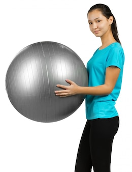 Kobieta i piłka do ćwiczeń