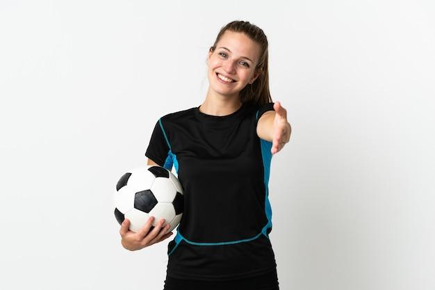 Kobieta młody piłkarz na białym tle drżenie rąk za zamknięcie dobrą ofertę