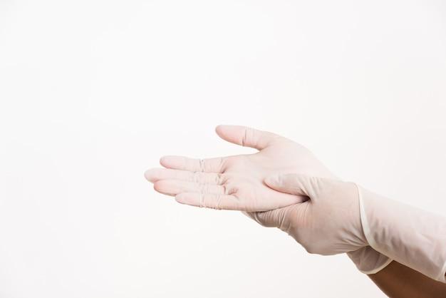 Kobieta na rękę rękawiczki gumowe