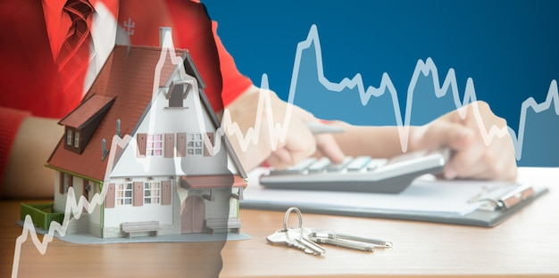 Kobieta oblicz i zaplanuj swoją dobrą nieruchomość z nieruchomościami agencji nieruchomości.