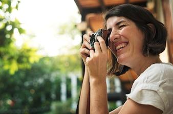 Kobieta podróżnika fotografa wakacyjna styl życia wycieczka
