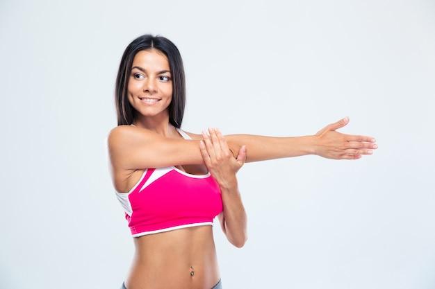 Kobieta szczęśliwy sportowe rozciąganie rąk