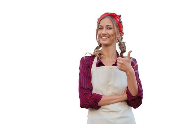 Kobieta ubrana w fartuch białe tło kaukaska właścicielka firmy w średnim wieku w mundurze