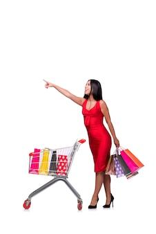 Kobieta w czerwieni sukni po robić zakupy odizolowywam na bielu