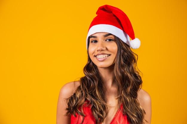 Kobieta w nowym roku ubrania santa hat wakacje boże narodzenie