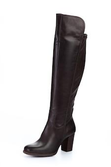 Kobieta wysokości kolanowi rzemienni buty odizolowywający na białym tle