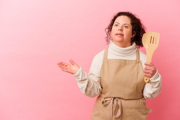 Kobieta z zespołem downa gotowania