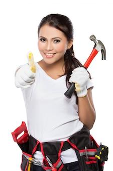 Kobiety mienia narzędzie pokazuje kciuk up