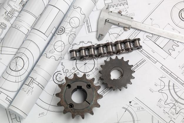 Koła napędowe, łańcuchy i rysunki techniczne części i mechanizmów przemysłowych