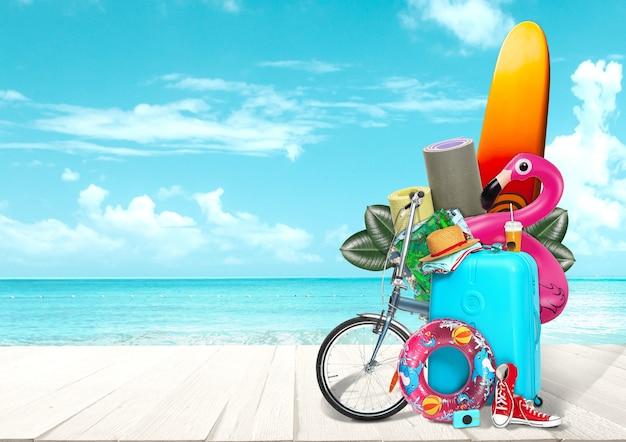 Kolaż bagażu do podróży przed widokiem na ocean. pojęcie czasu letniego, kurortu, podróży, podróży, podróży. potrzebne rzeczy. deska serfingowa, rower, maty sportowe, czapka, gumowy pierścień, buty i okulary przeciwsłoneczne
