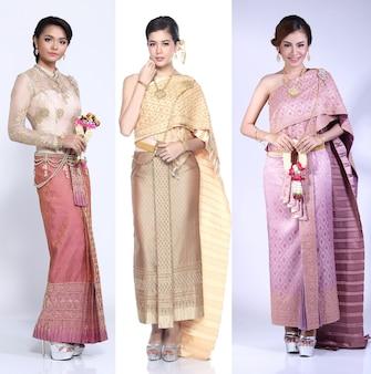 Kolaż unikalnej sukienki, azjatyckie kobiety tajskie w tradycyjnym stroju narodowym złotego cesarza tajlandii w starożytnym pałacu okresu siam ayutthaya, oświetlenie studyjne czarne ciemne tło, stojak na całe ciało