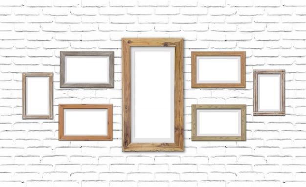 Kolekcja brązowe drewniane ramki na mur z cegły