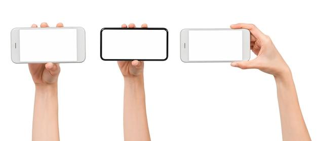 Kolekcja gestów ręki trzymającej smartfon z pustym ekranem, makieta dla aplikacji mobilnej, nowoczesny design ze ścieżką przycinającą.