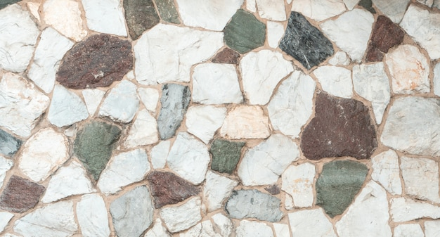 Kolor zdobiony tekstura kamiennej podłogi, zewnętrzna ściana z granitu na zewnątrz
