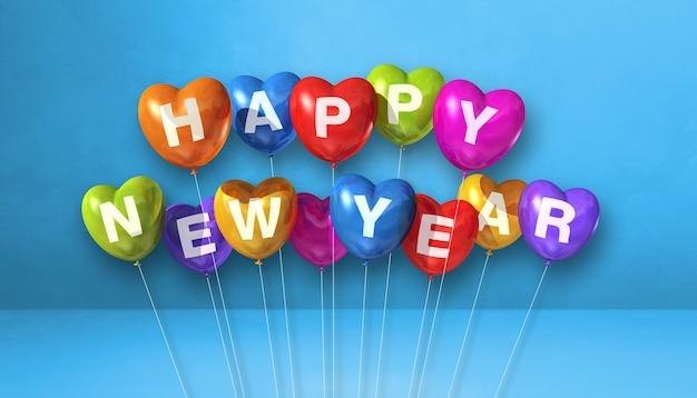Kolorowe balony kształt serca szczęśliwego nowego roku na niebieskim tle betonu. baner poziomy. renderowanie ilustracji 3d