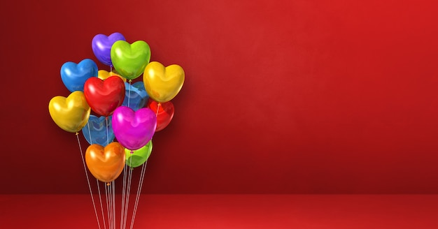 Kolorowe balony w kształcie serca kilka na czerwonej ścianie. poziomy baner. renderowania 3d