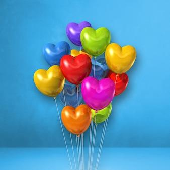 Kolorowe balony w kształcie serca kilka na tle niebieskiej ściany. renderowania 3d ilustracji
