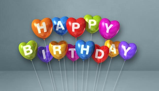 Kolorowe balony w kształcie serca z okazji urodzin na szarej ścianie sceny. renderowanie ilustracji 3d